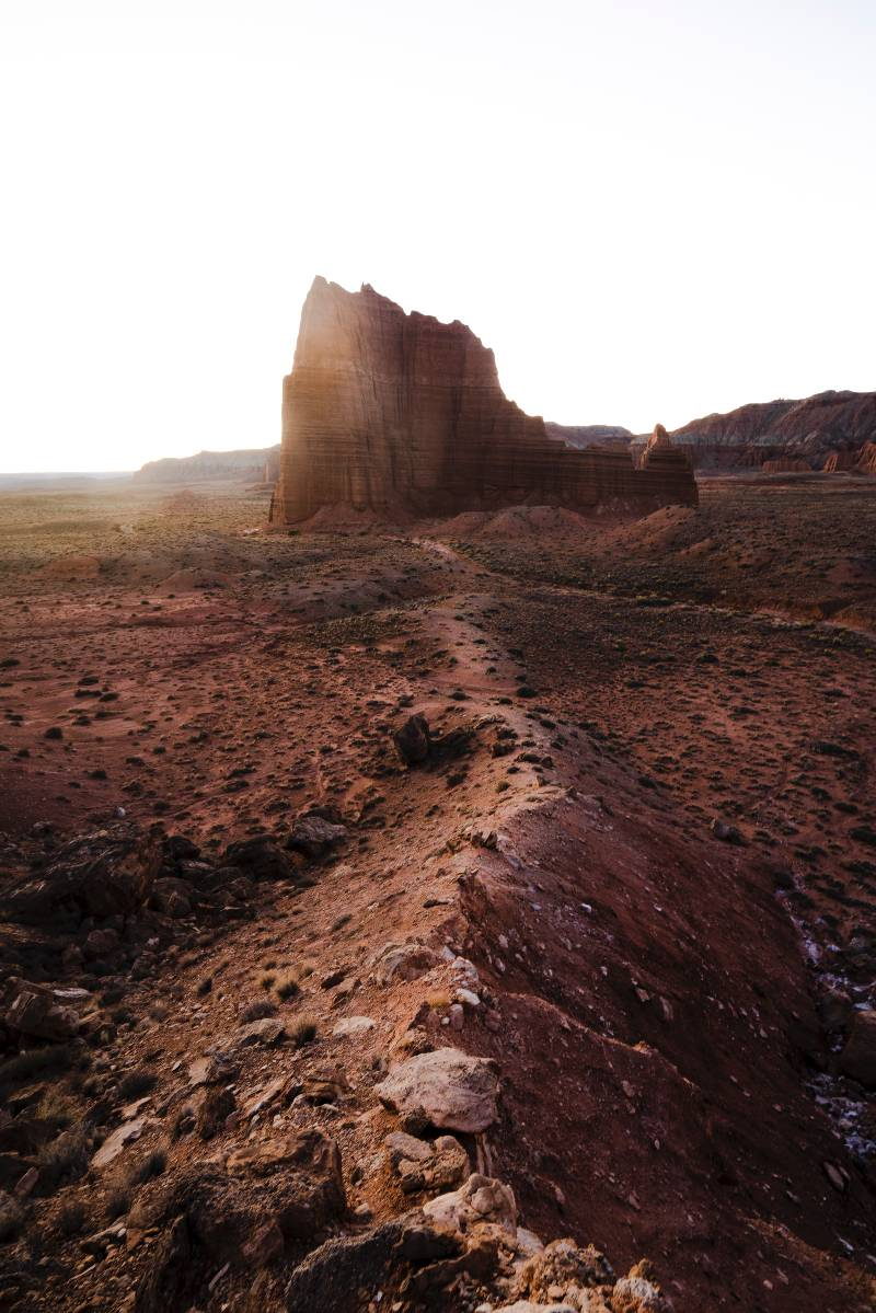 A ridge trail and rock formation in Capitol Reef National Park
