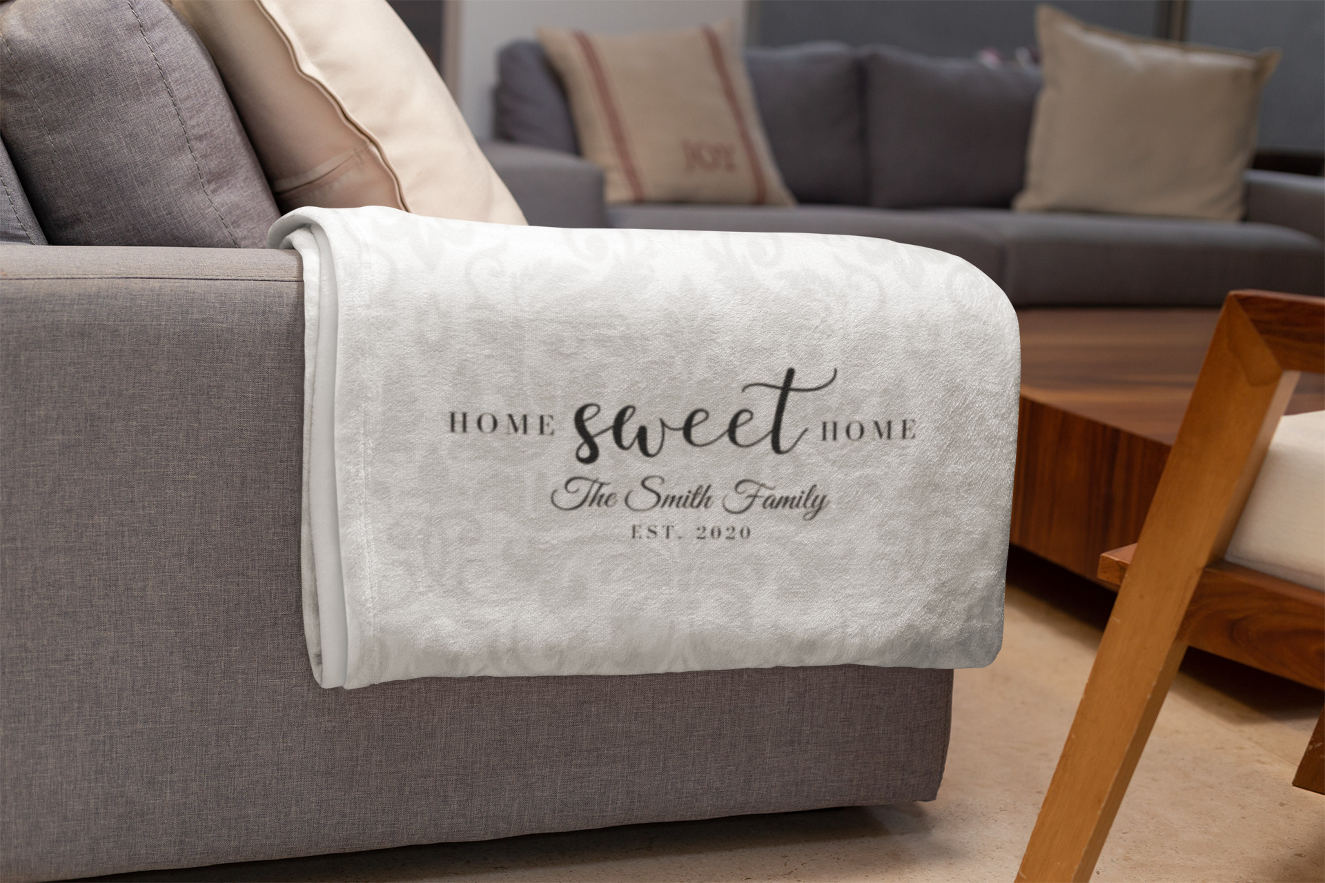 Personalized Homeowner Blanket sitting on a couch