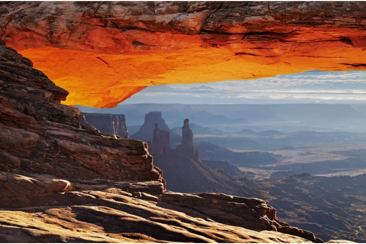 The view through Mesa Arch in Canyonlands, one of the Mighty 5 Utah parks