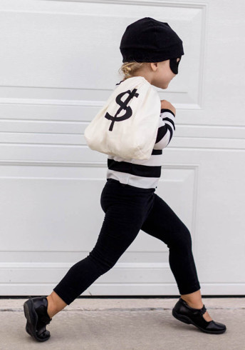 Child in bandit costume with money bag