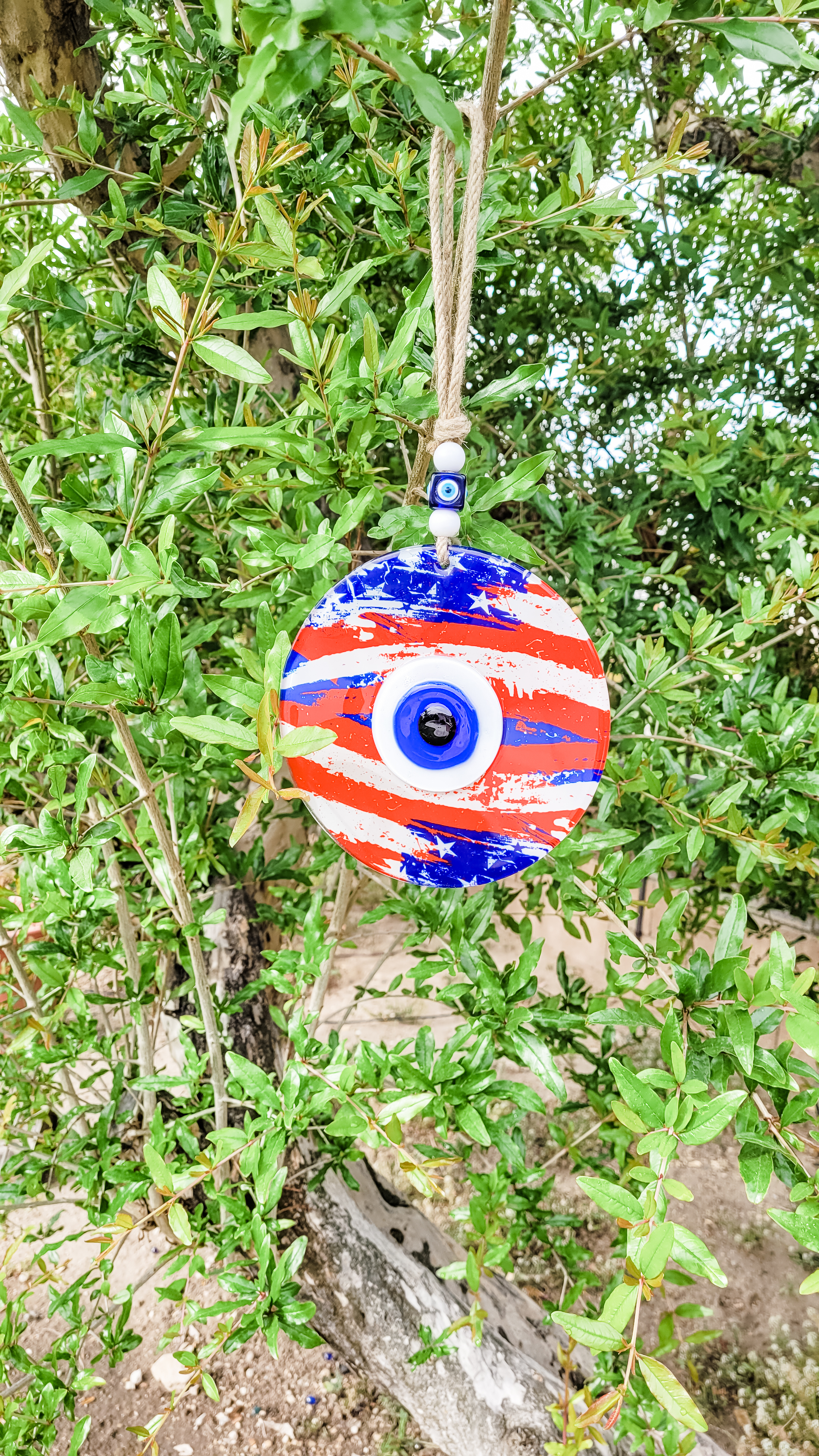 hang an evil eye amulet in your garden