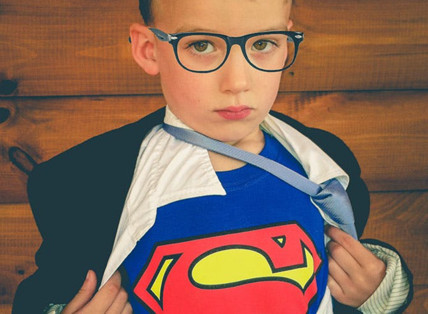 Young man in Superman costume