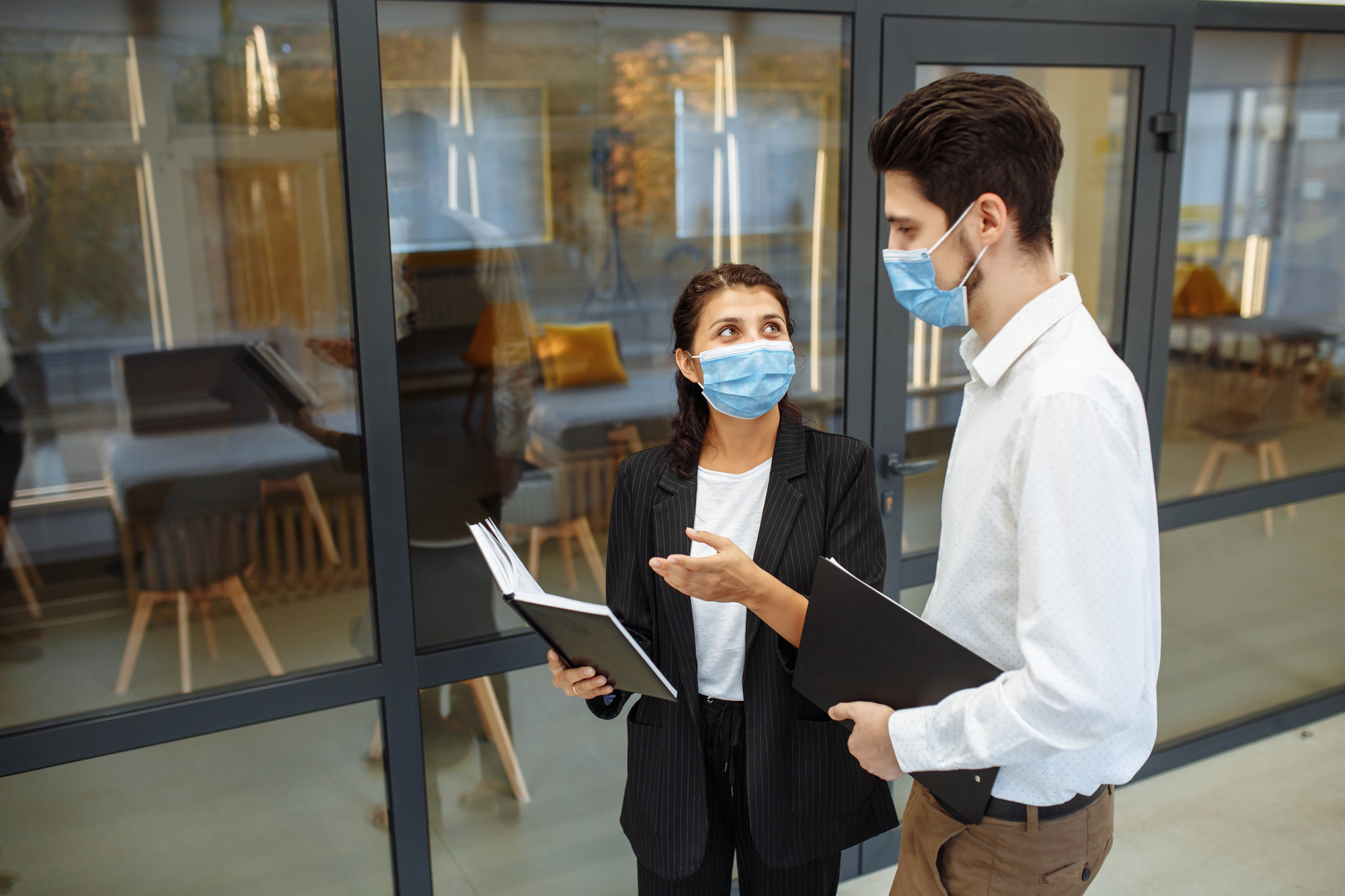 girl-and-guy-at-office-with-masks