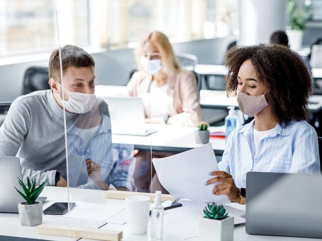 co-workers-with-plexiglas-in-office