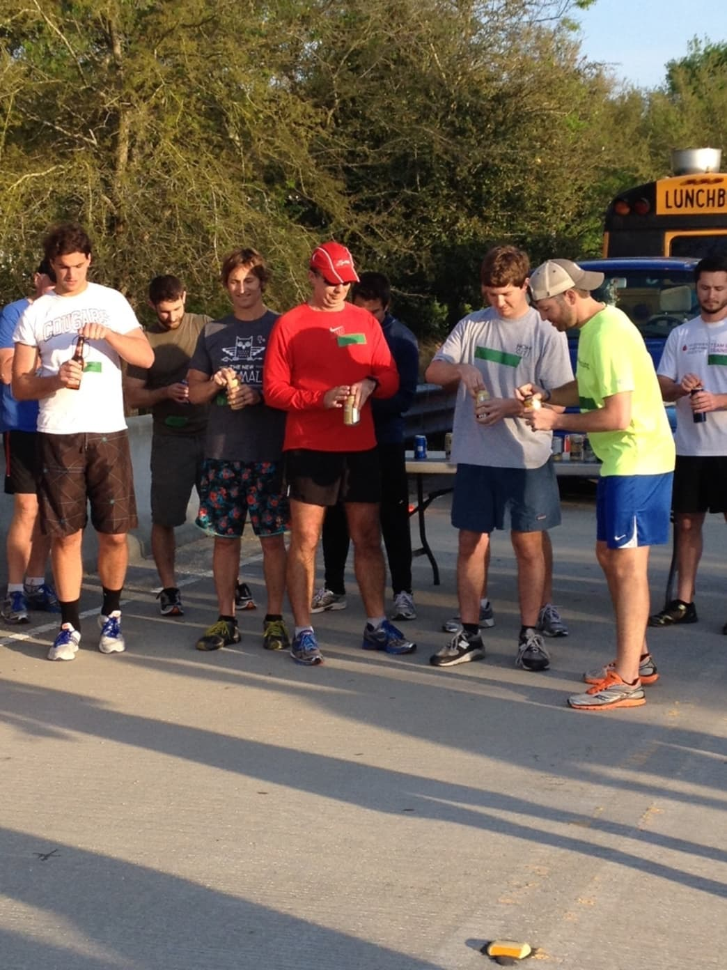 Racers prepare to chug at the Beer Mile hosted by Onshore Racing
