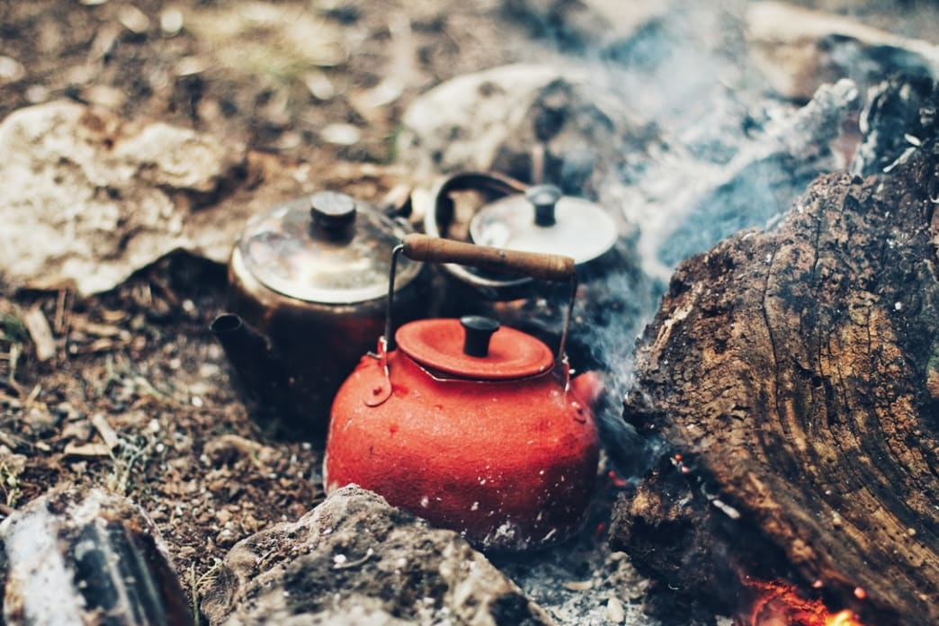 Boiling kettles on the fire