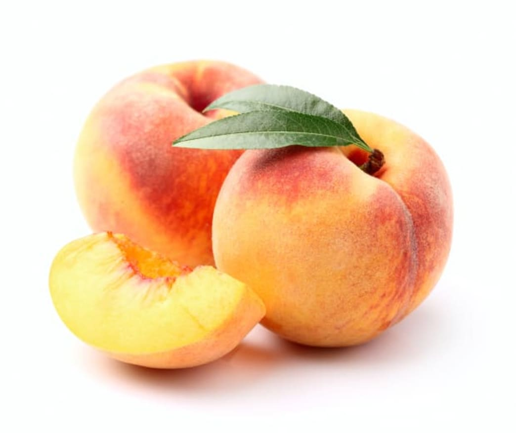 .two peaches with a peach slice next to them.  - Better Nutrition