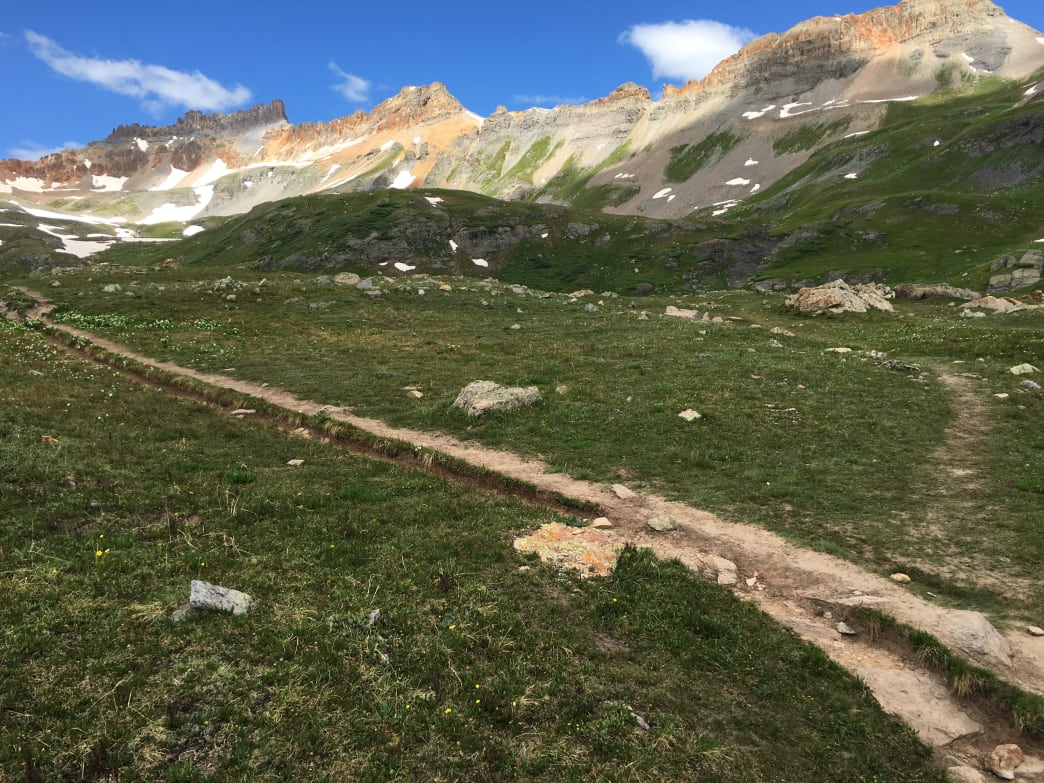 """Trail braiding"" occurs in sensitive areas like Ice Lakes Basin when hikers don't yield to each other. These trails take years to recover. Aaron Hussmann"