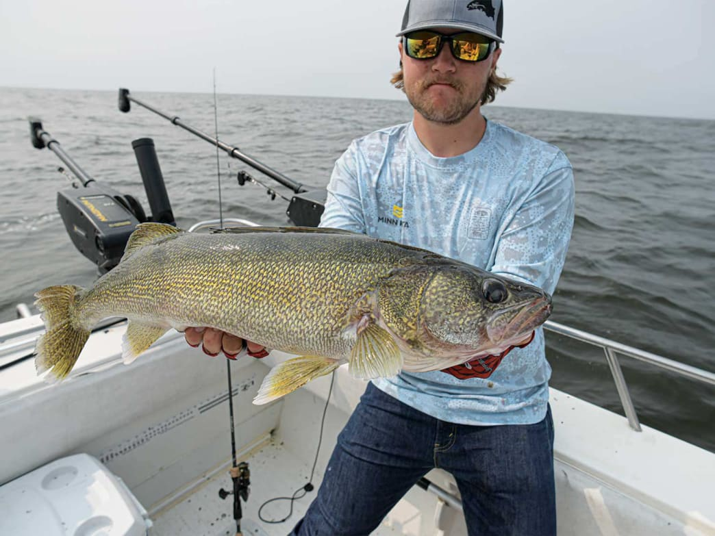 To land big walleyes, it helps to have a net with a long handle.