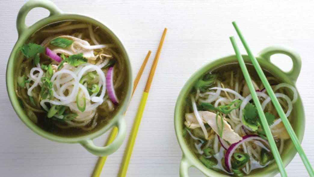 .Daikon Chicken Pho in bowls with chopsticks - Clean Eating Magazine