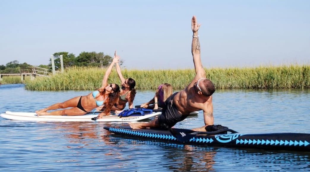 Take a fitness class on a stand-up paddleboard.