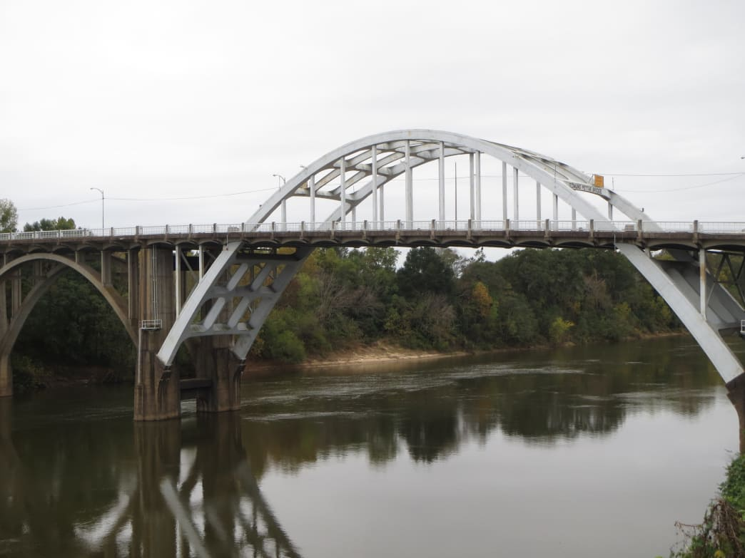 Passing through Selma, the Alabama River flows beneath the Edmund Pettis Bridge, an infamous landmark of the Civil Rights movement.      Joe Cuhaj