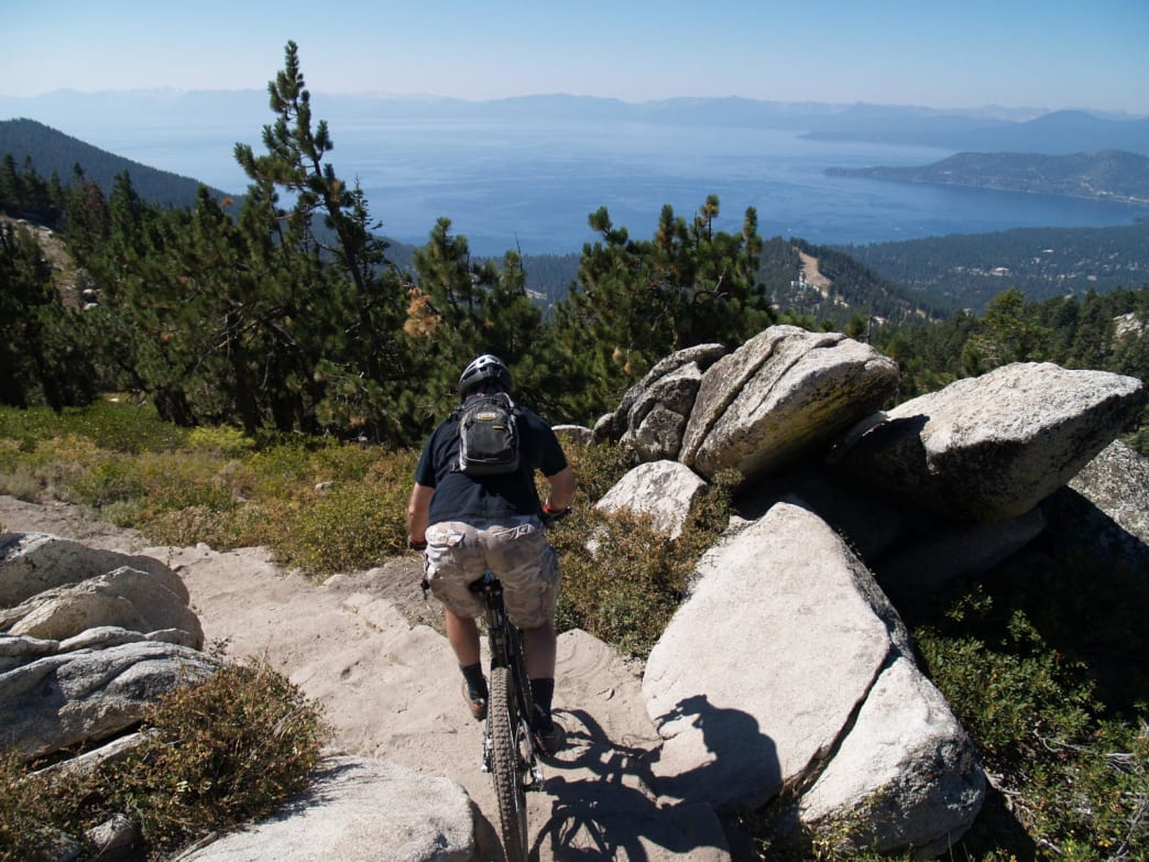 A mountain biker takes full advantage of the snow-free trails above North Lake Tahoe.