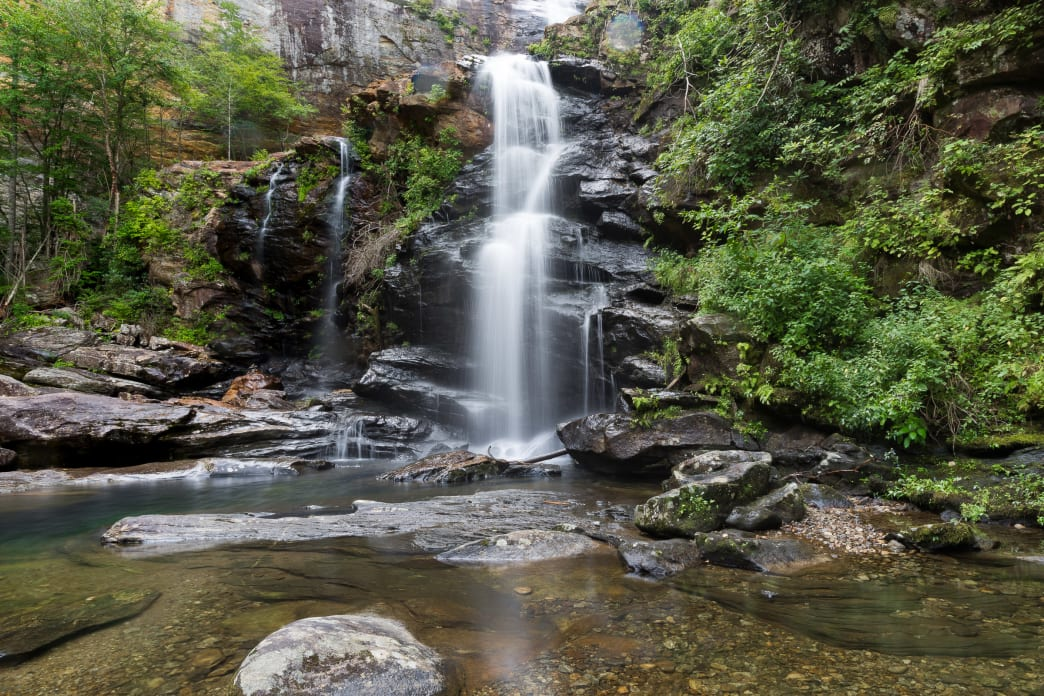 Hike the High Falls Trail at Lake Glenville near Cashiers, NC to a stunning double-drop waterfall.