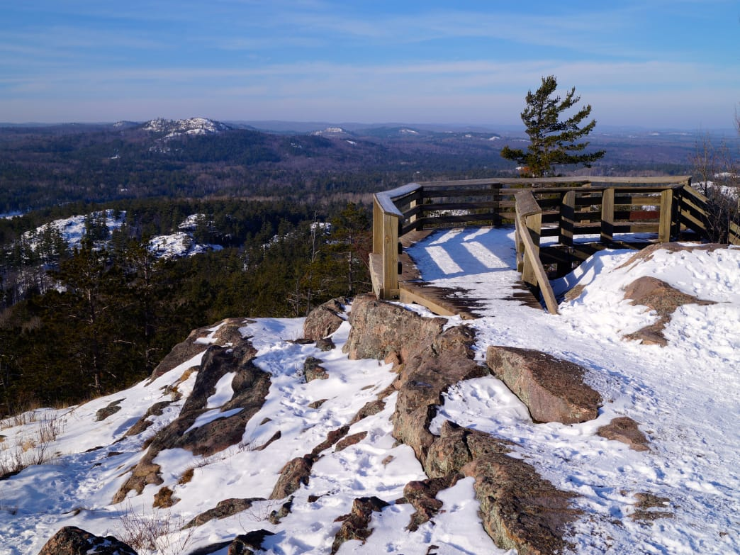Even with a light dusting of snow, the peaks of Michigan's Upper Peninsula, like Sugarloaf Mountain, are worthy of a visit in winter.