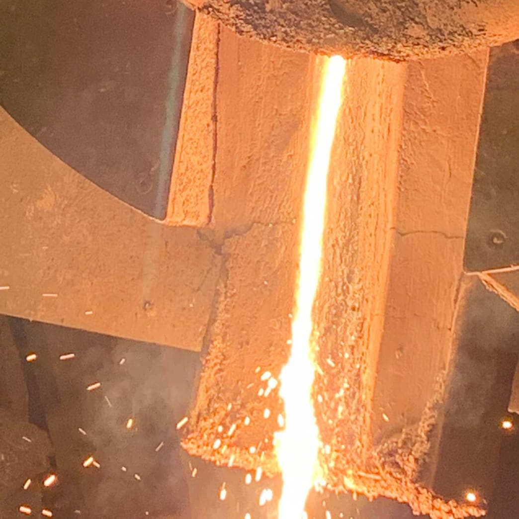 Molten metal being poured from the induction furnace.