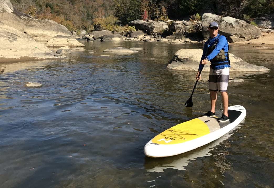 Try out stand-up paddleboarding to test your stability.