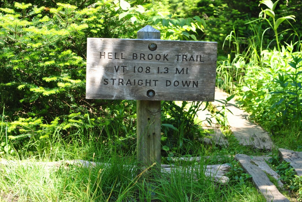 Sign at the top of the Hell Brook Trail heading down to Route 108 in Smugglers Notch.