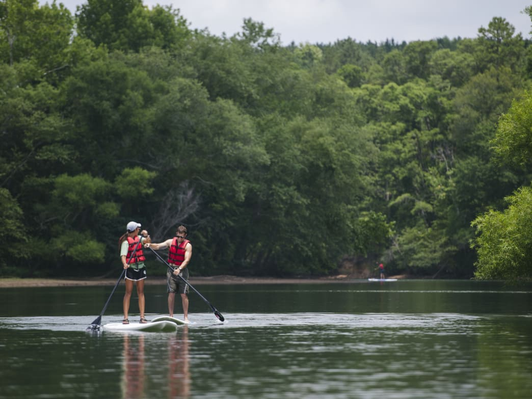 Rent sit-on-top kayaks and SUP boards at the Whitewater Center's dock.