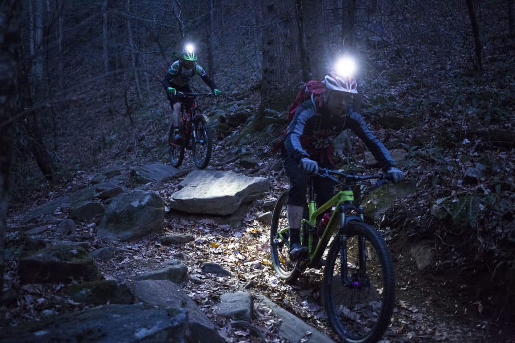 David Riggs (rear) and David Neiles (front) riding the creek side of the Daniel Ridge Loop in Pisgah National Forest, NC.