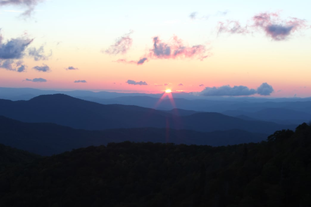 The sun rises over Graveyard Fields, a popular hiking destination along the Blue Ridge Parkway.
