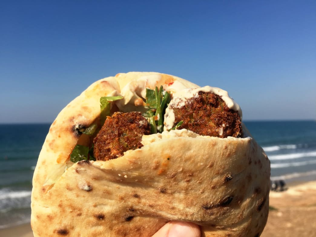 A falafel pita with hummus is a tasty way to satisfy your appetite.