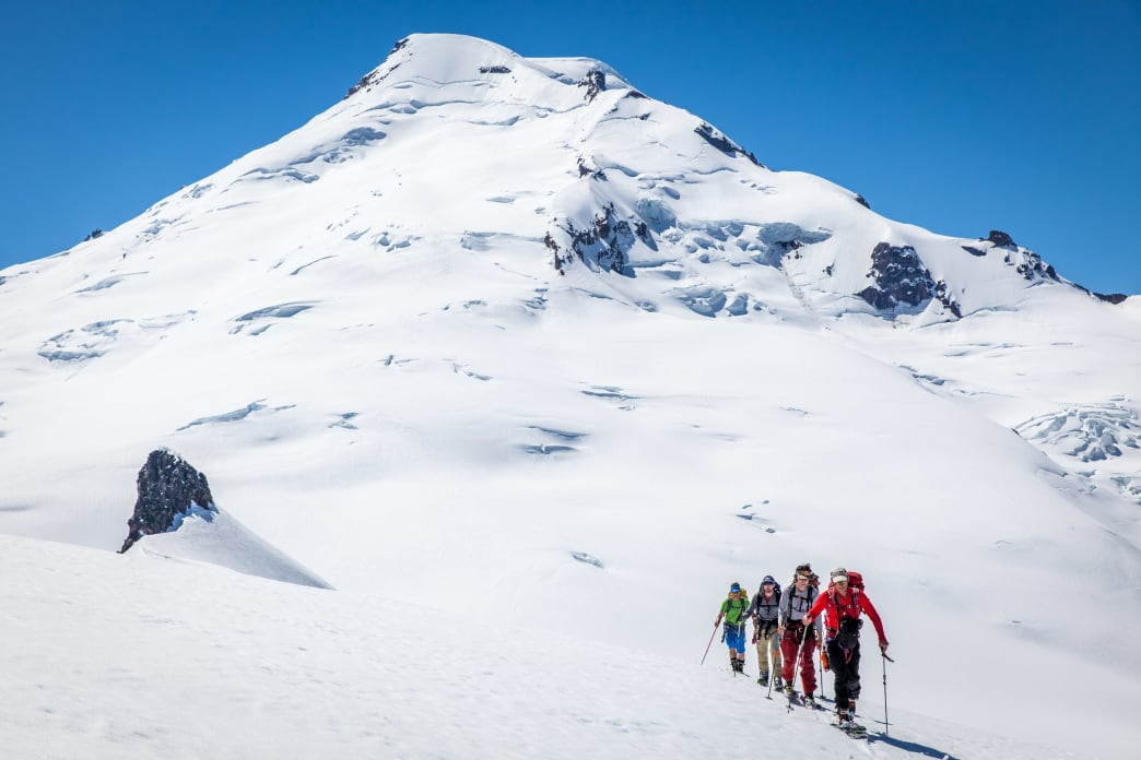 On the flanks of the Mazama Glacier with the summit of Mount Baker in the background.