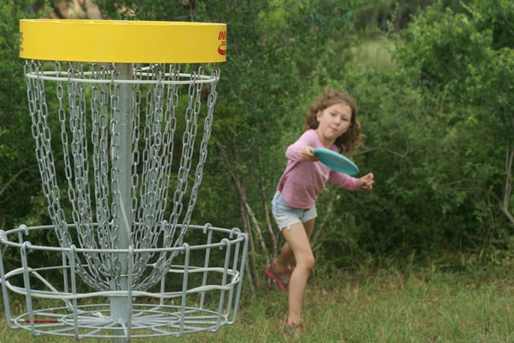 Head to the woods this Thanksgiving for some family disc golfing.