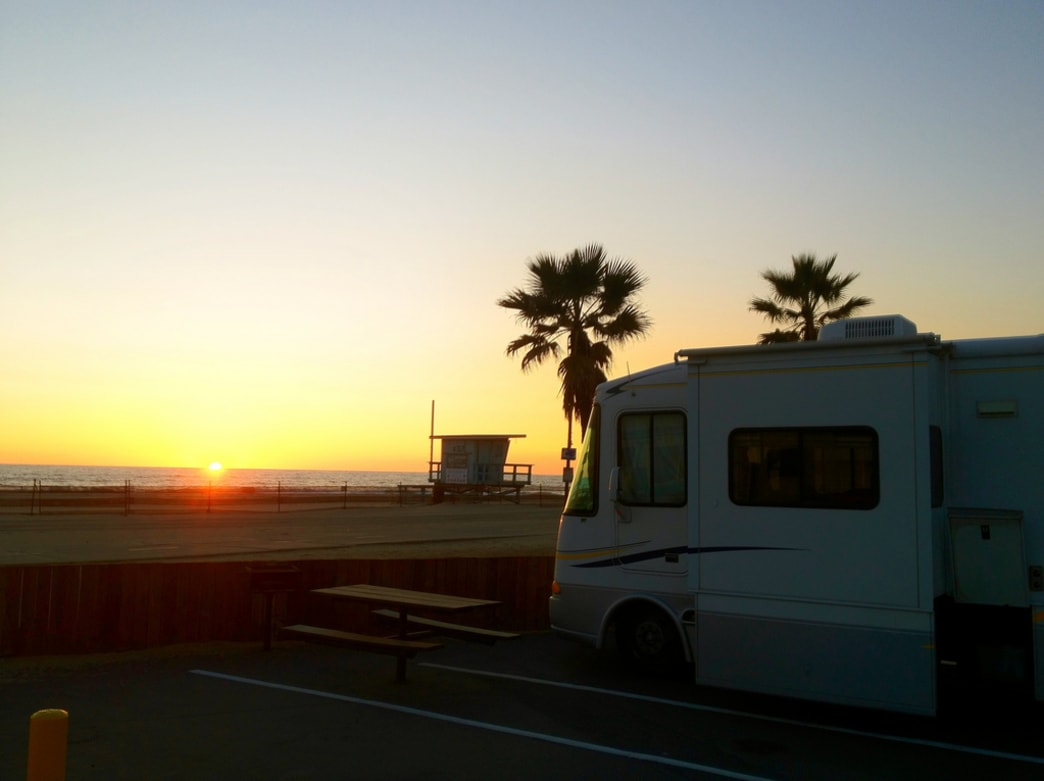 The sun sets over Dockweiler State Beach