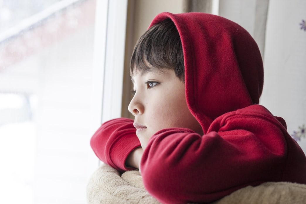 boy staring out window