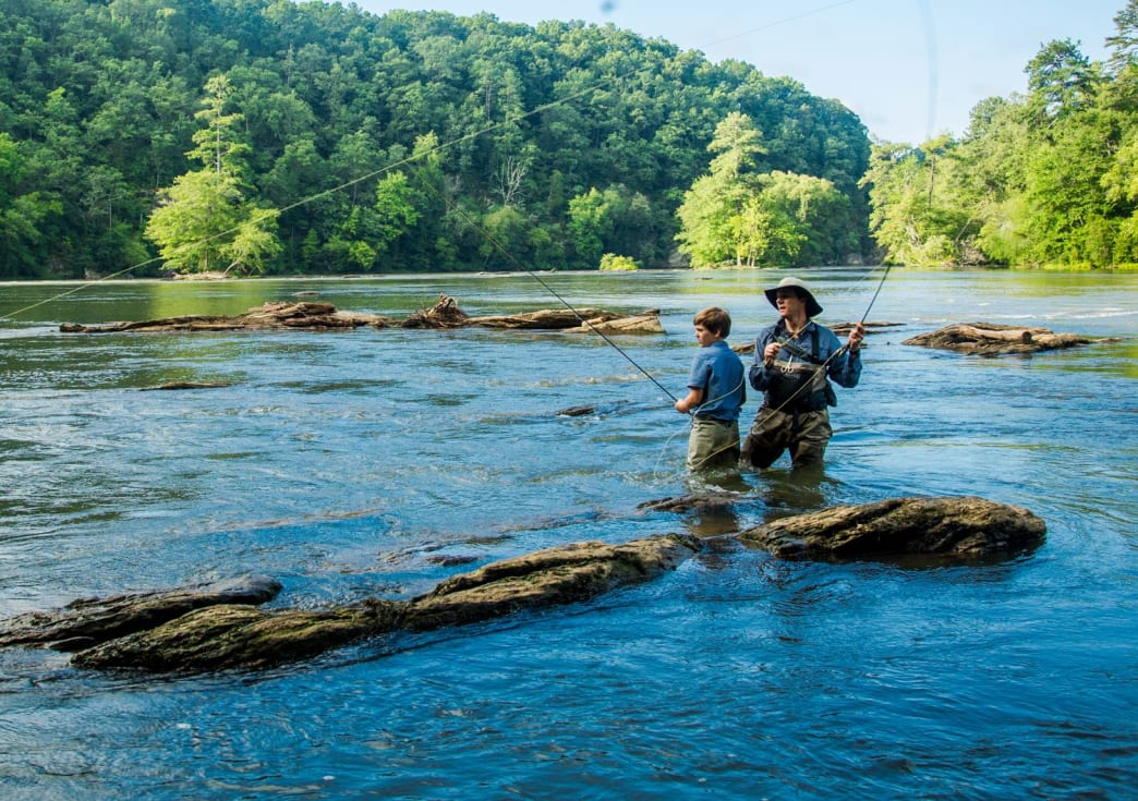 Visitors enjoy the calm waters and sunny weather that makes the Chattahoochee River so appealing to fish and fly-fishing