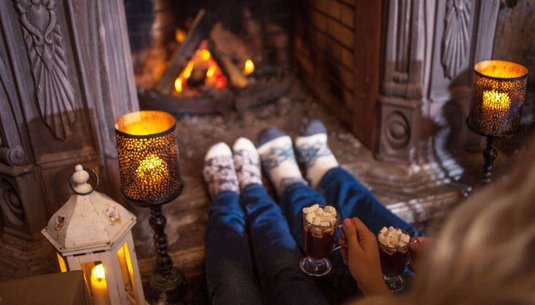 Set the mood with some candles and hot chocolate. Pure winter bliss.