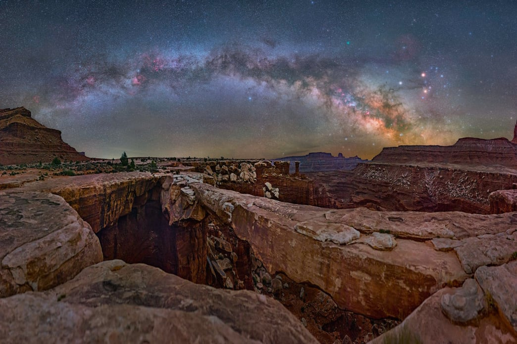 Musselman Arch, Canyonland National Park. The alarm went off at 2:45 to awaken me to take this picture. I staggered out. A nearby lonesome coyote cried out to me, perhaps warning me of the drop and my sleepiness.