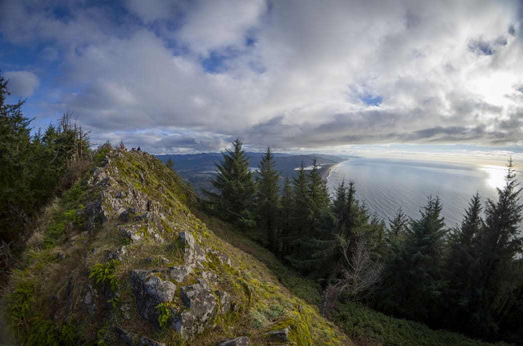 The windswept summit of Neahkahnie Mountain requires hikers to tackle a quick rock scramble; those who do will enjoy views of nearby Manzanita.