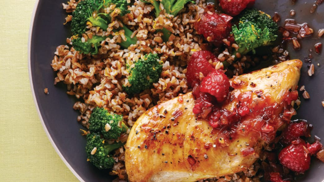 Chicken in pan with raspberries, broccoli and more.  Clean Eating Magazine