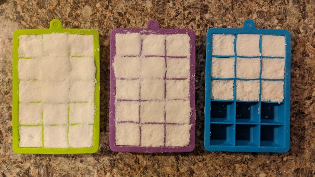 I made the mistake of overfilling the green and purple trays, which made it that much harder to unmold the tablets when they were dry. When you fill your trays, make sure the silicone separators are all visible (like in the blue tray on the right).