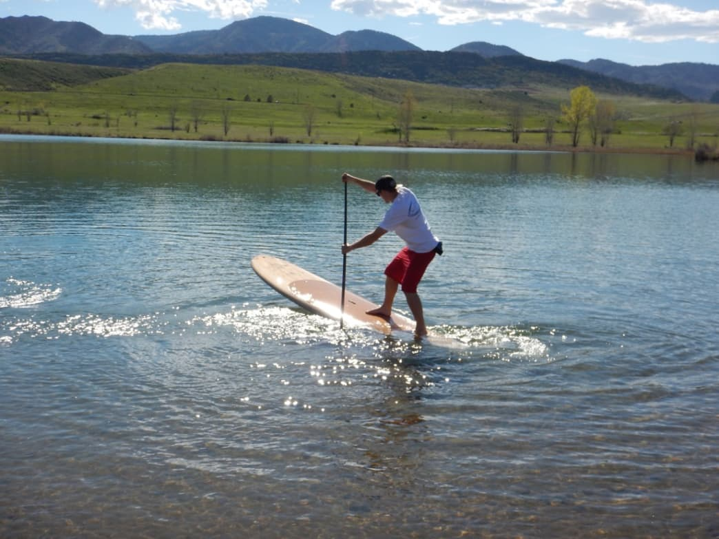 On a sunny day at Chatfield's Gravel Ponds, Surf'SUP Colorado's Alex Mauer demonstrates a pivot turn on a BIC Sport Earth board, which is made of sustainable materials.