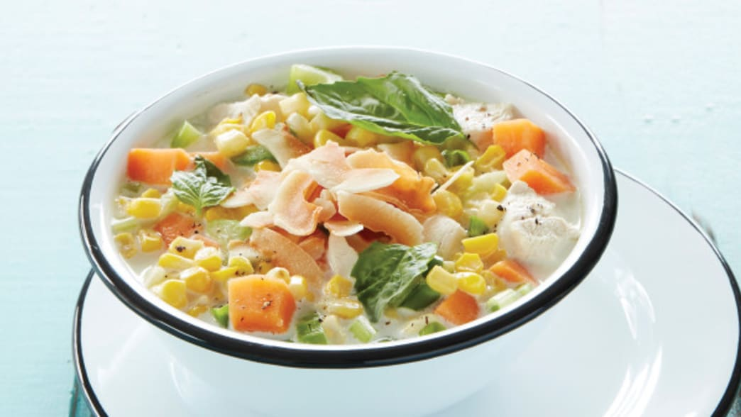 Bowl of coconut chicken corn chowder - Clean Eating Magazine
