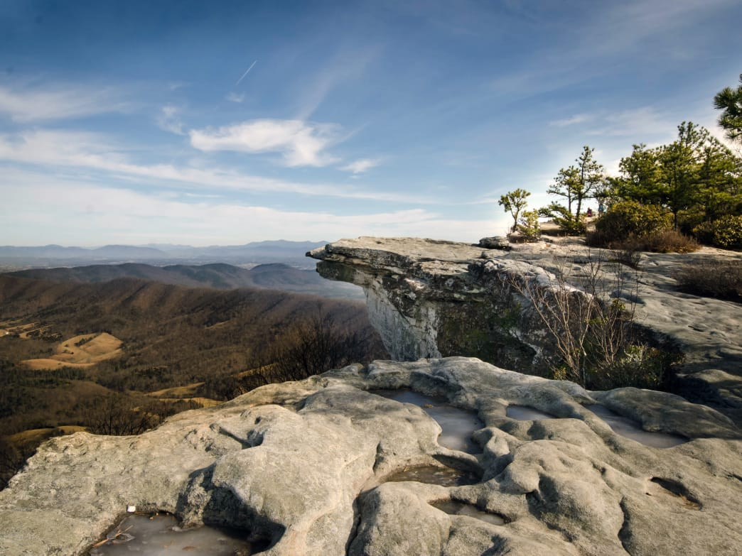 Enjoy the McAfee Knob, a giant, rock-slab outcropping that sticks out like a diving board over the forest.