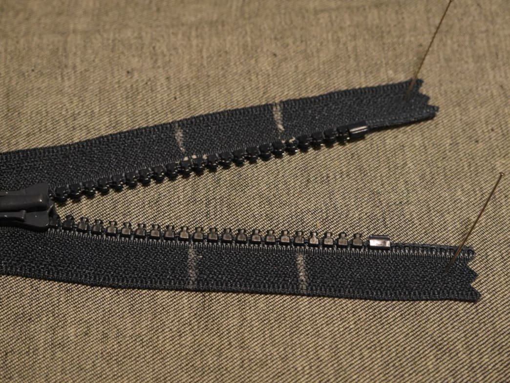 Use tailor's wax to mark the desired length of the shortened zipper (left) and an inch from the top of the current length (right).