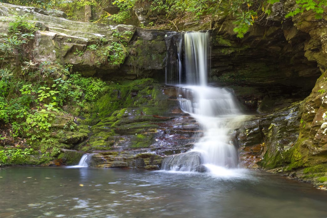 Hike the Catawba Falls Trail near Old Fort, east of Asheville, through a waterfall-filled river valley.
