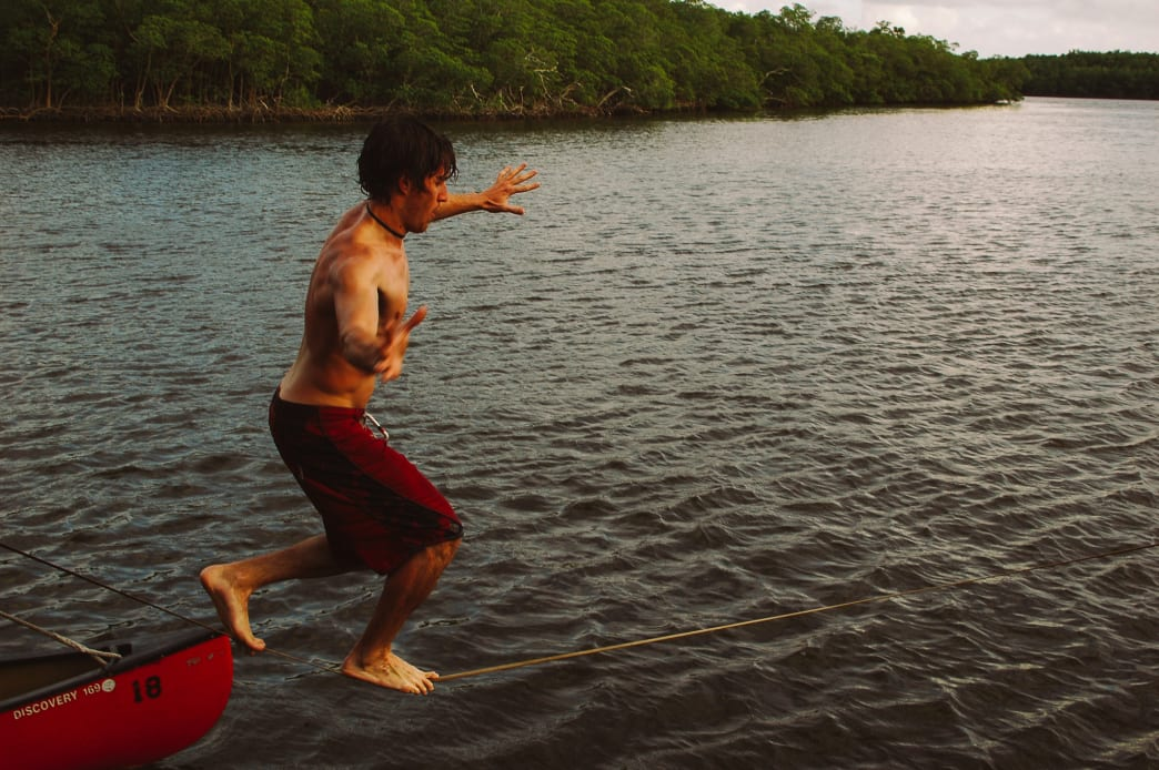 Slacklining during a canoe trip in the Florida Mangrove swamps.