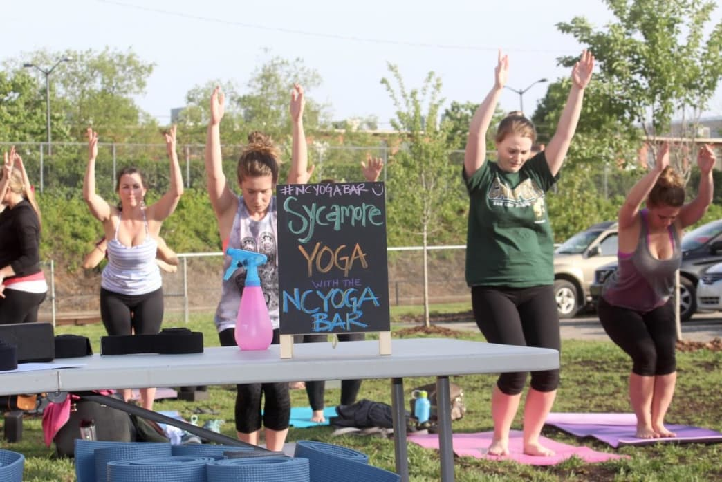 Breweries like Sycamore make great use of their outdoor space for weekly yoga classes.