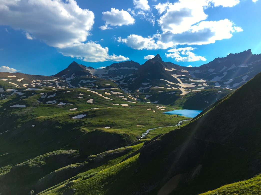 The dream-like blue waters of Ice Lake contrast with the green alpine tundra of the San Juan Mountains. Aaron Hussmann