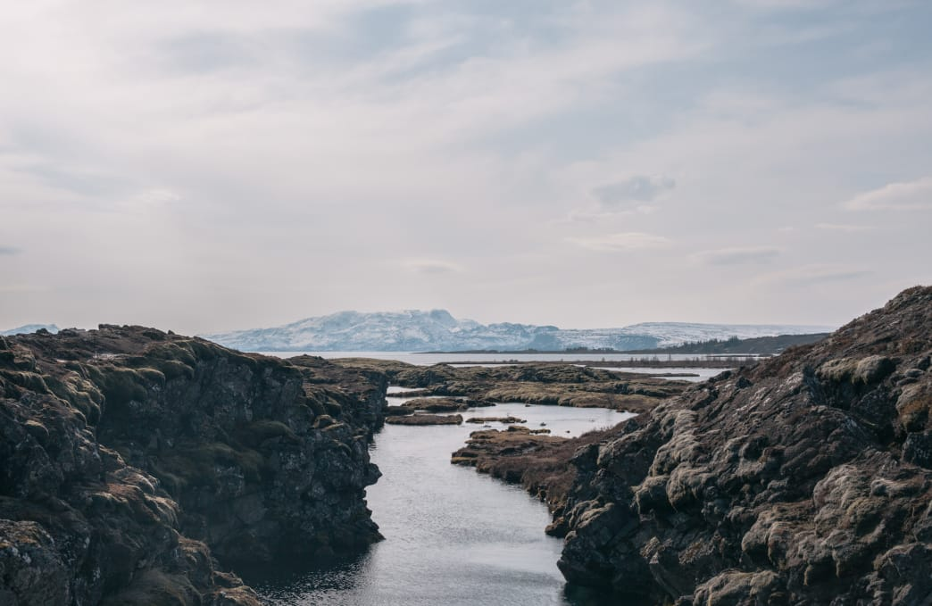 From land, the Silfra Fissure doesn't look like much more than a muted gray and brown landscape.