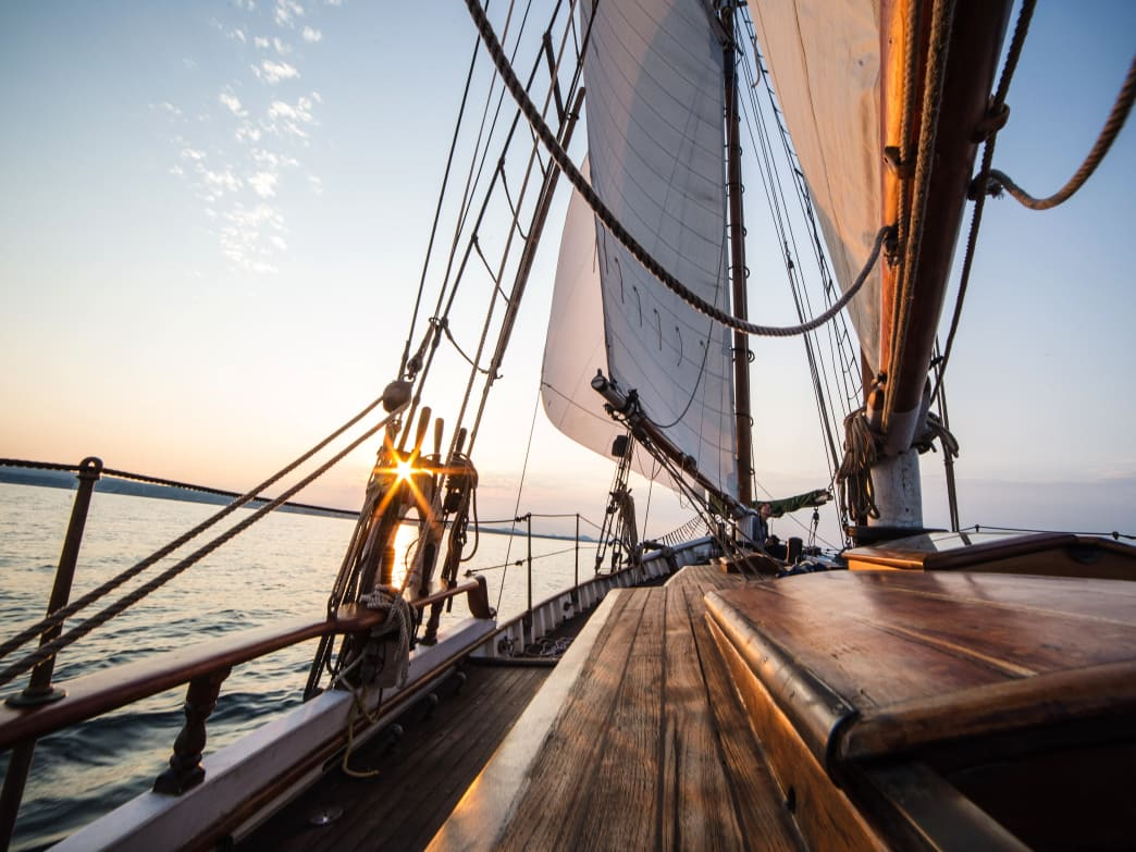 Dreaming of sunset on the deck? There are many ways to find a gig crewing on a sailboat.