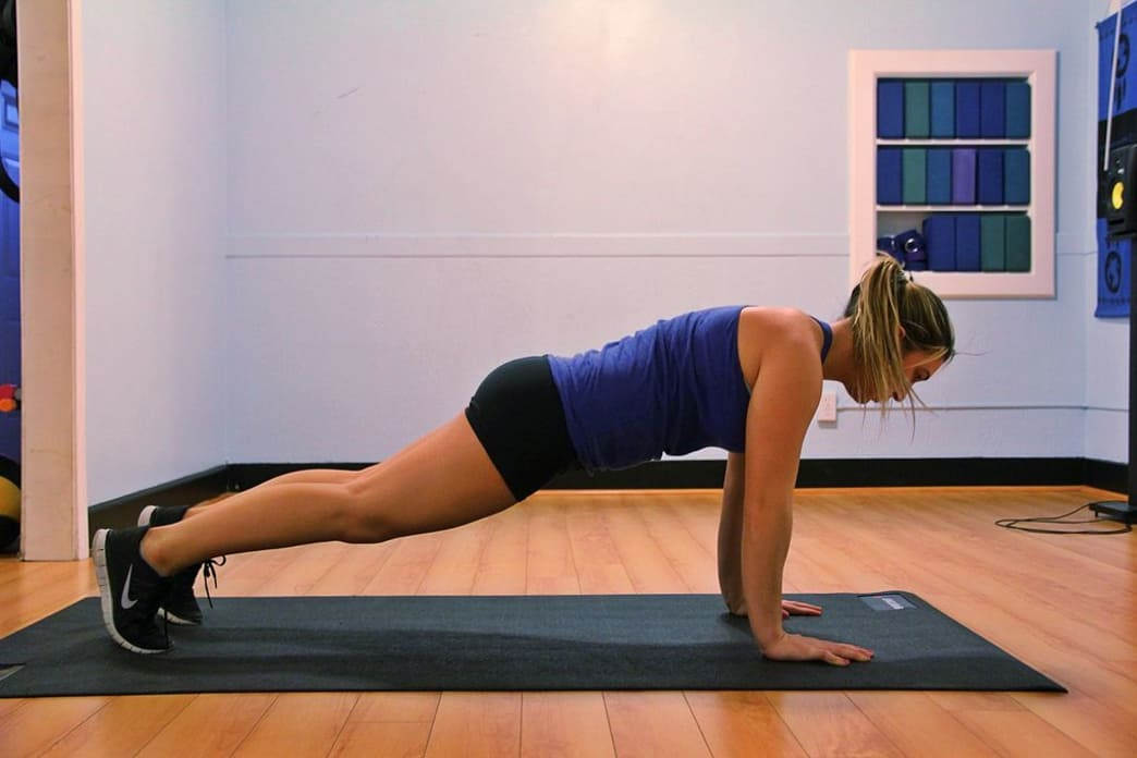 Plank pose and paddling go hand in hand.