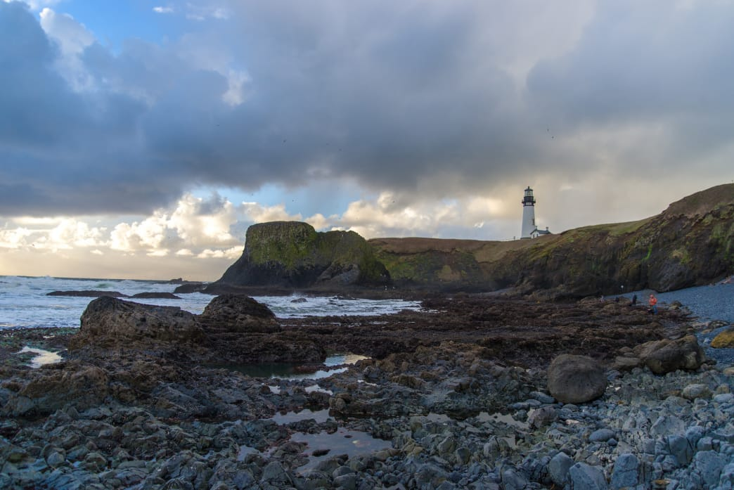 The view of Yaquina Head Lighthouse from Cobble Beach.