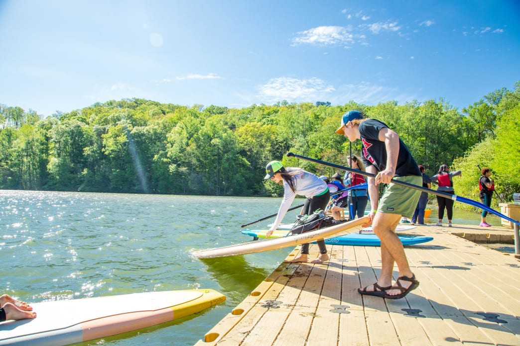 Visitors prepare to spend some time paddle boarding on the Chattahoochee River