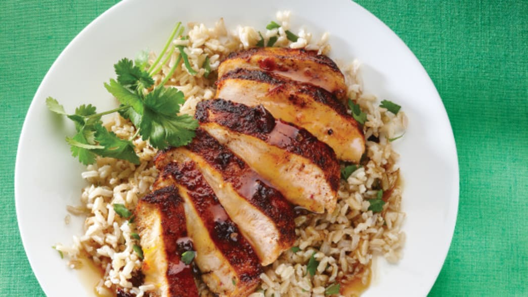 .Plated Orange Chipotle chicken on a bed of rice - Clean Eating Magazine